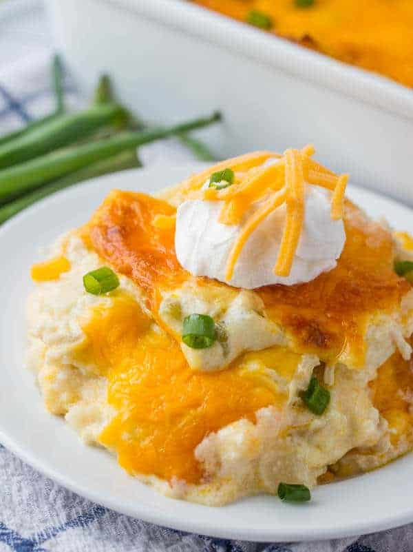 chicken tortilla casserole on plate with sour cream