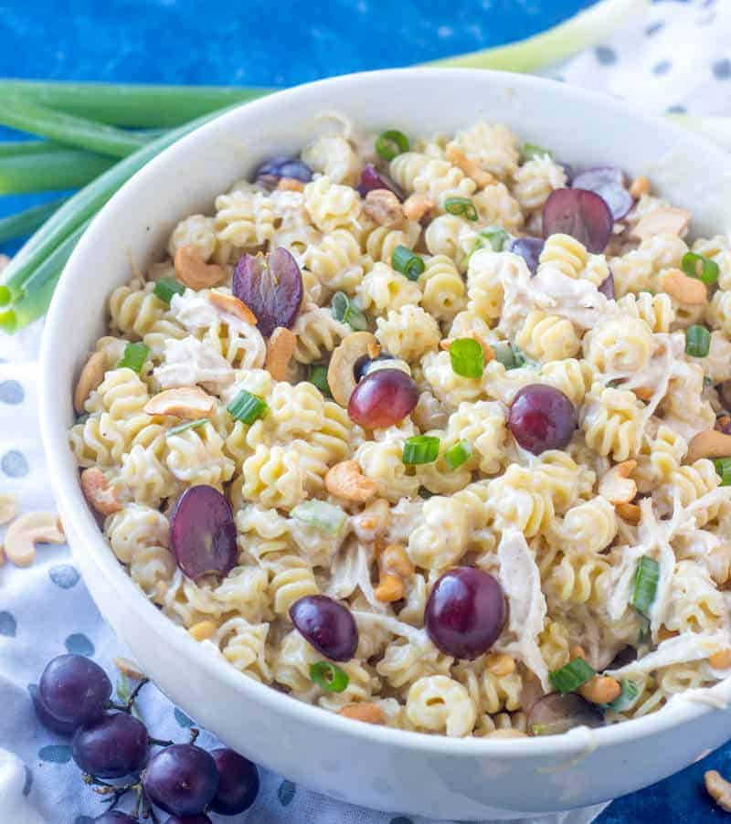 Cold Chicken Pasta Salad in serving bowl with grapes