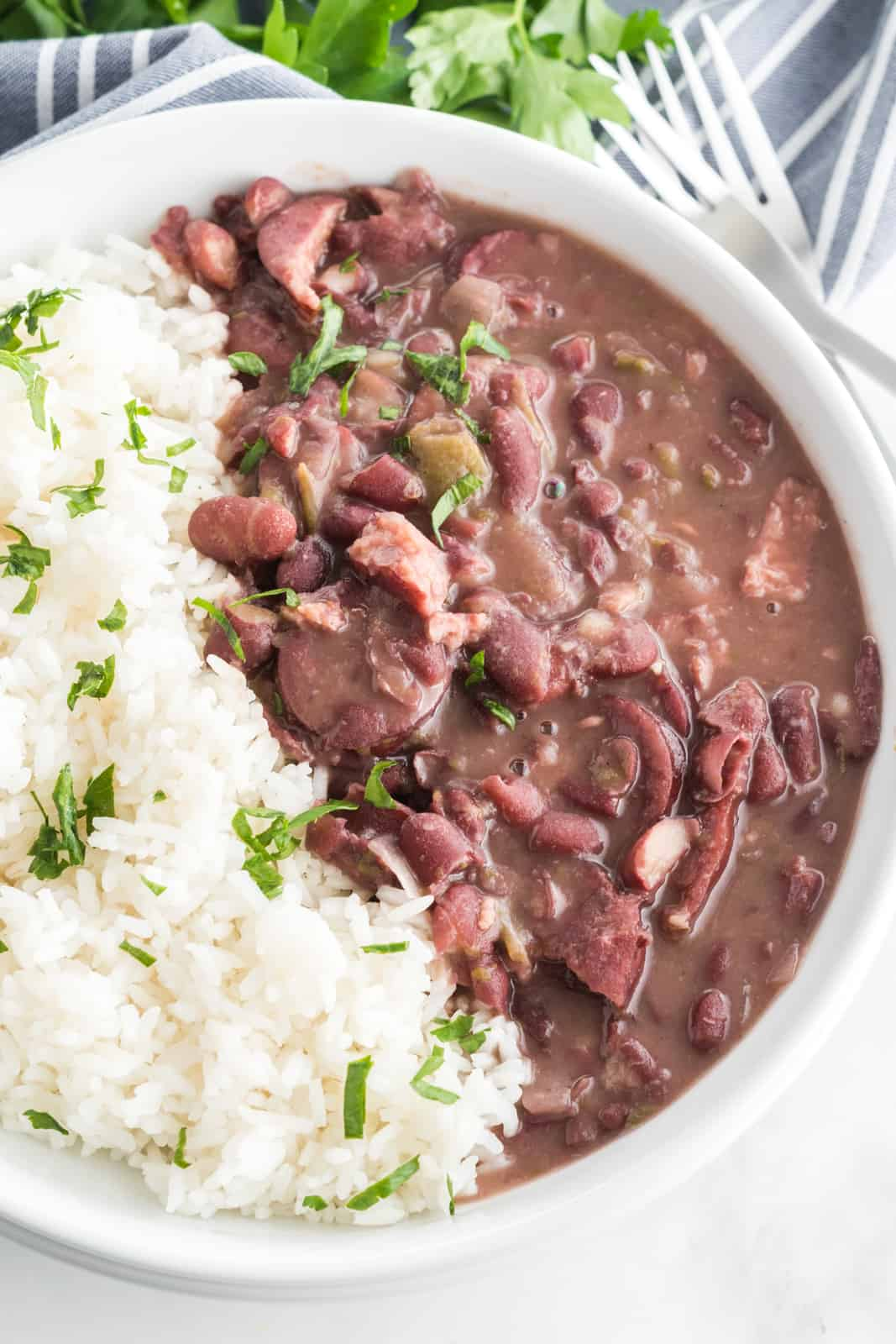 Overhead photo of red beans and rice in white bowl