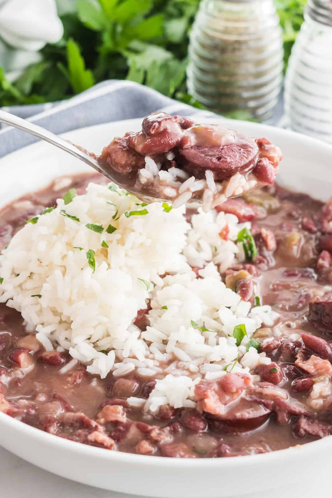 Spoon scooping up the slow cooker red beans and rice