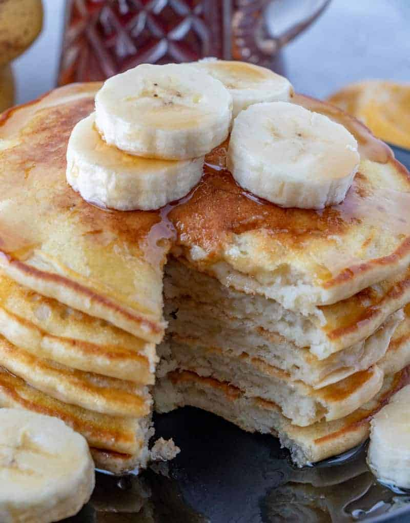 Banana pancakes on plate with slices taken out