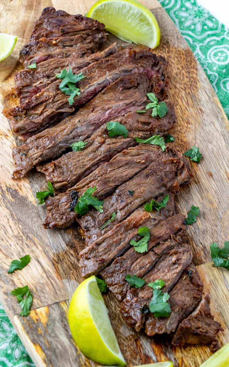 Carne asada freshly cut on cutting board