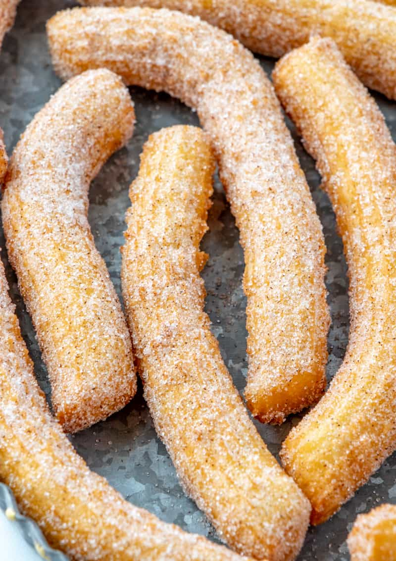 Up close of churros on serving tray