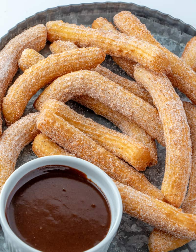 Churros on serving tray with chocolate dipping sauce
