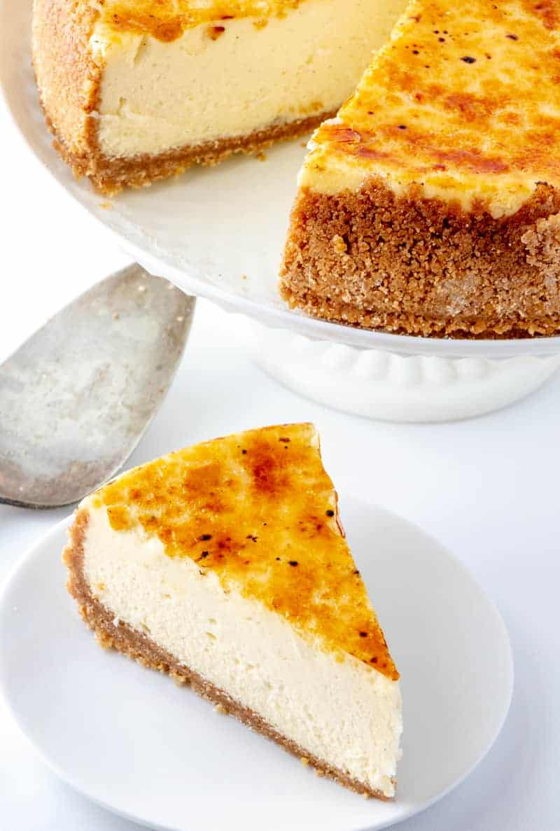 Creme Brûlée Cheesecake slice next to whole cheesecake