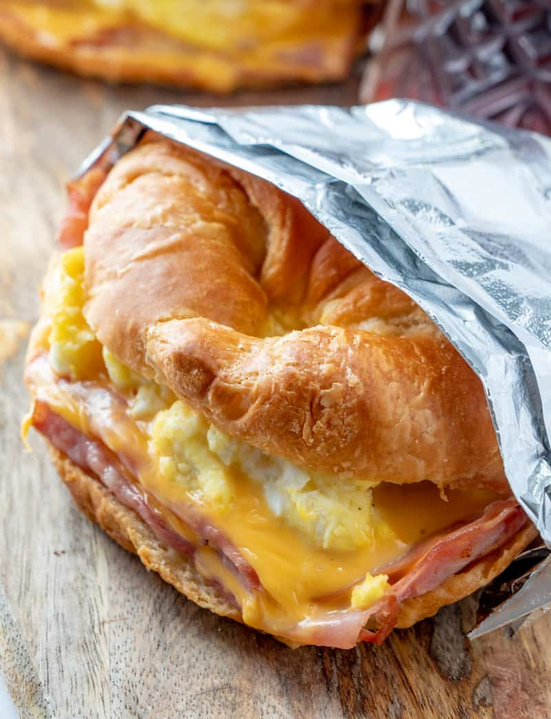 Side shot of easy breakfast croissant sandwich in tinfoil