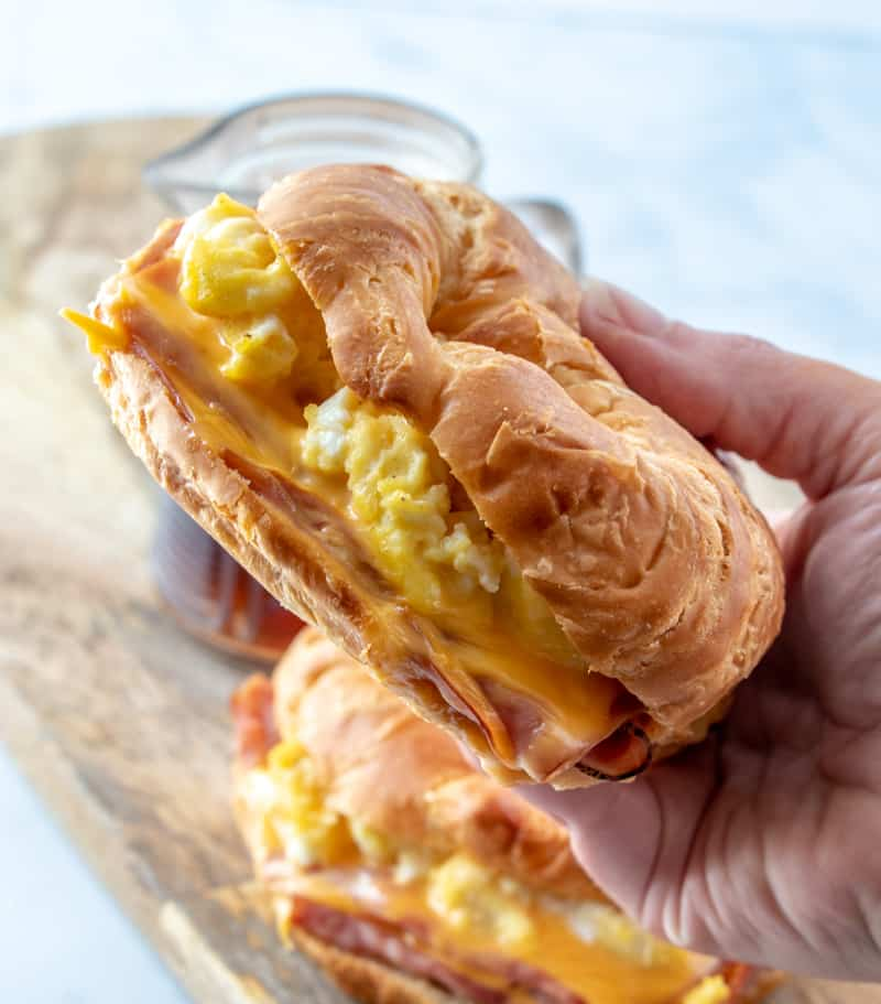 Hand holding one Breakfast Sandwich