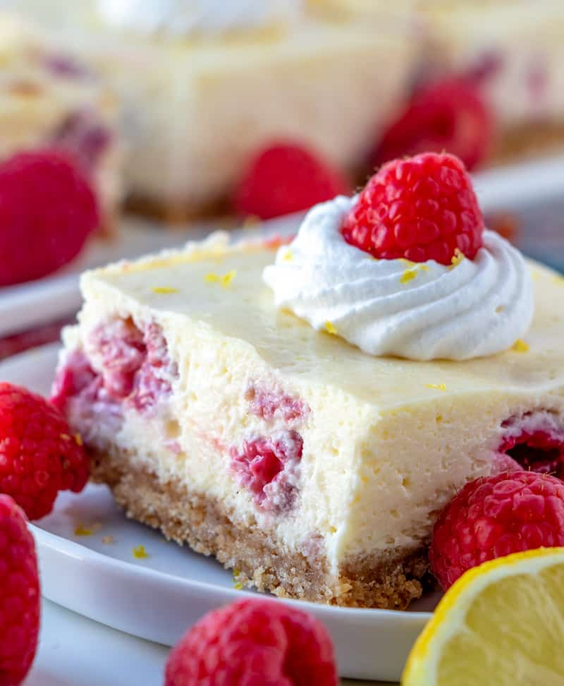 Side view on Lemon Raspberry Cheesecake Bars on plate