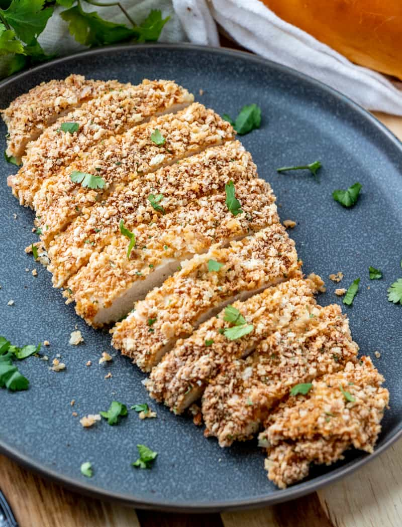 Ranch Baked Breaded Chicken sliced on black plate