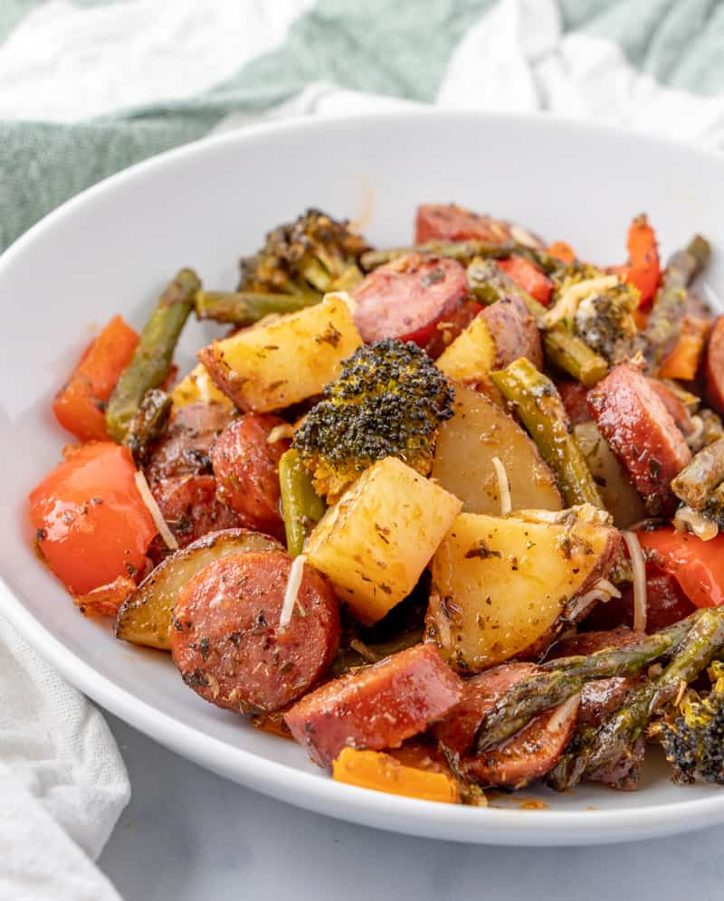 veggies and kielbasa in white bowl