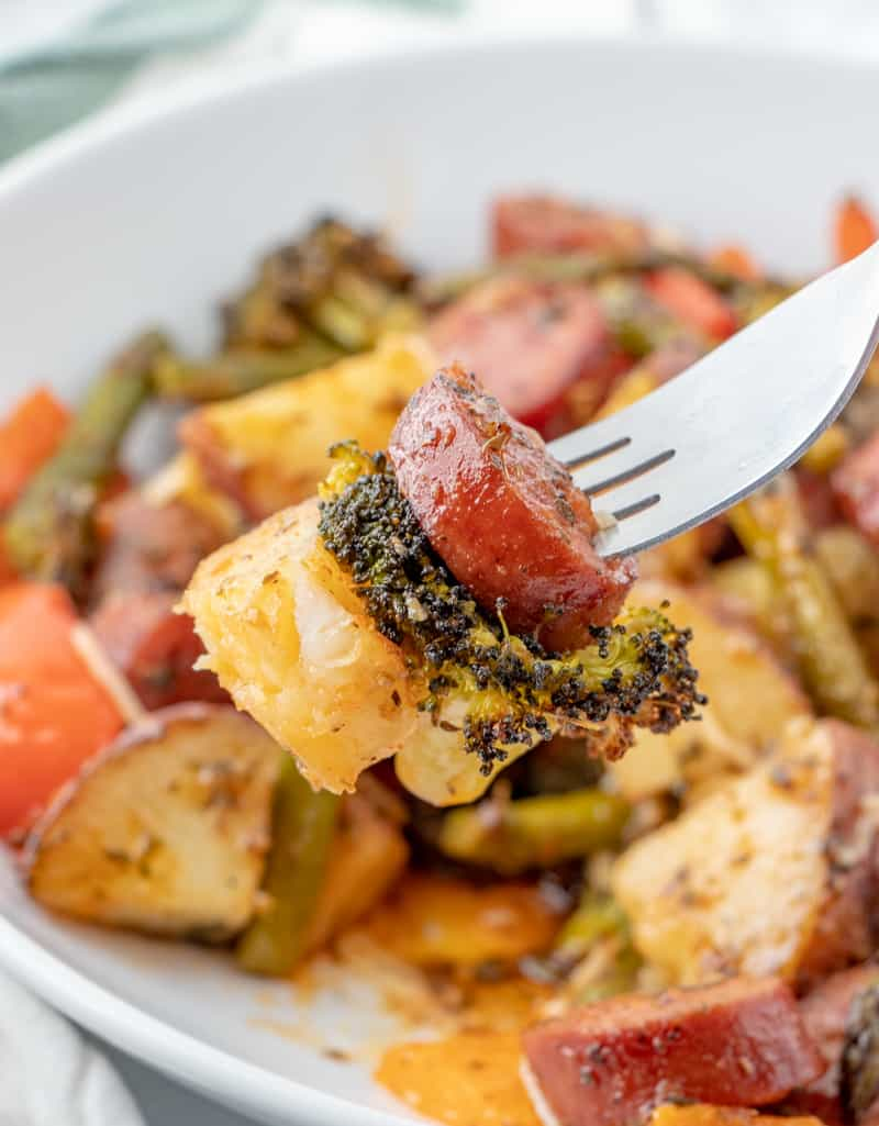 potato, broccoli and kielbasa on fork up close