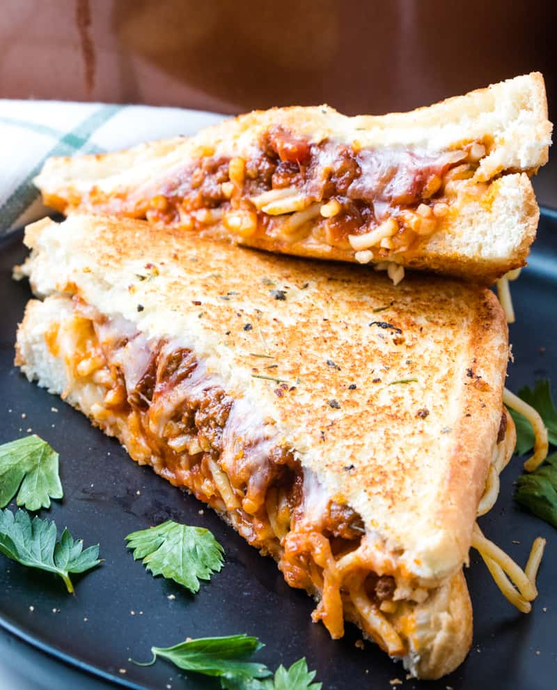 Close up side shot of spaghetti sandwich sliced on plate
