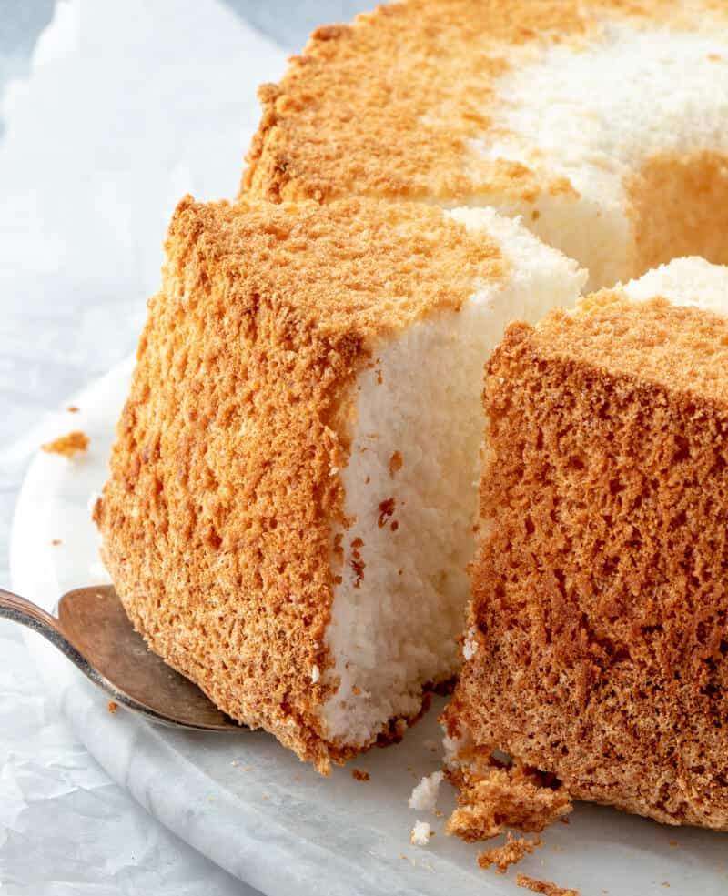 angel food cake with slice being taken out