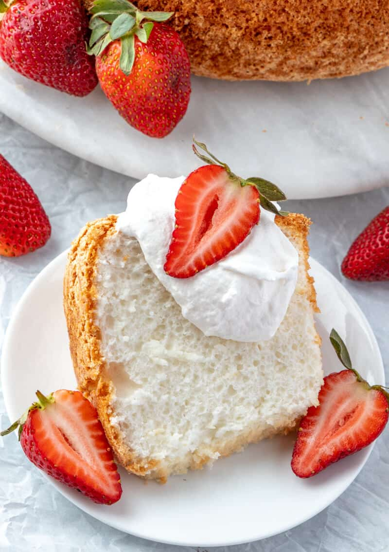 finished overhead shot of angel food cake with whipped cream and strawberries