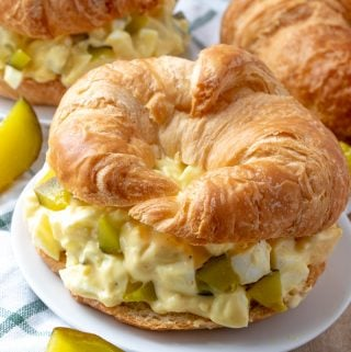 Egg salad on croissants with pickle spears
