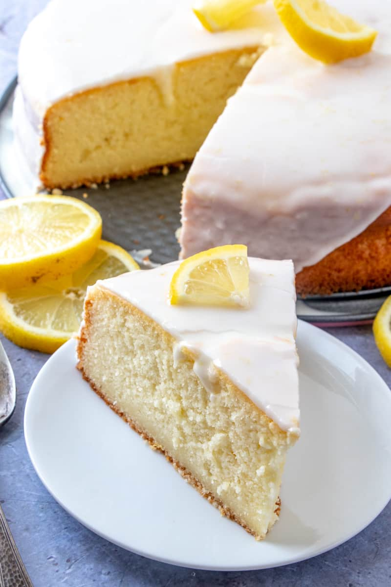 Slice of Ricotta Cake on plate with wedge of lemon on top