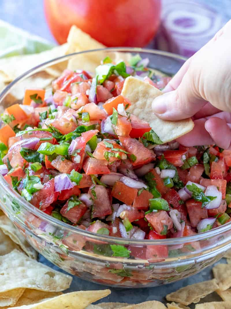 chip dipped in pico de Gallo