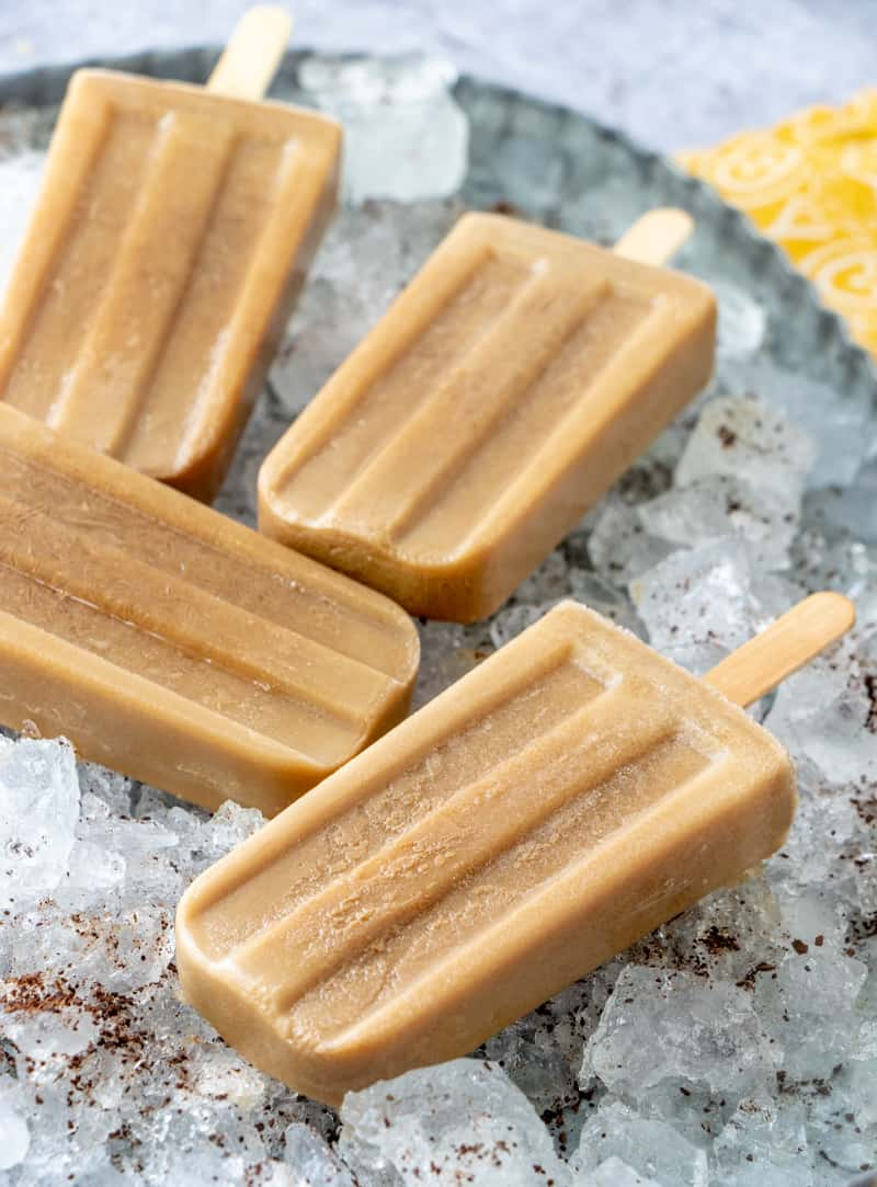 Popsicles on crushed ice in metal pan
