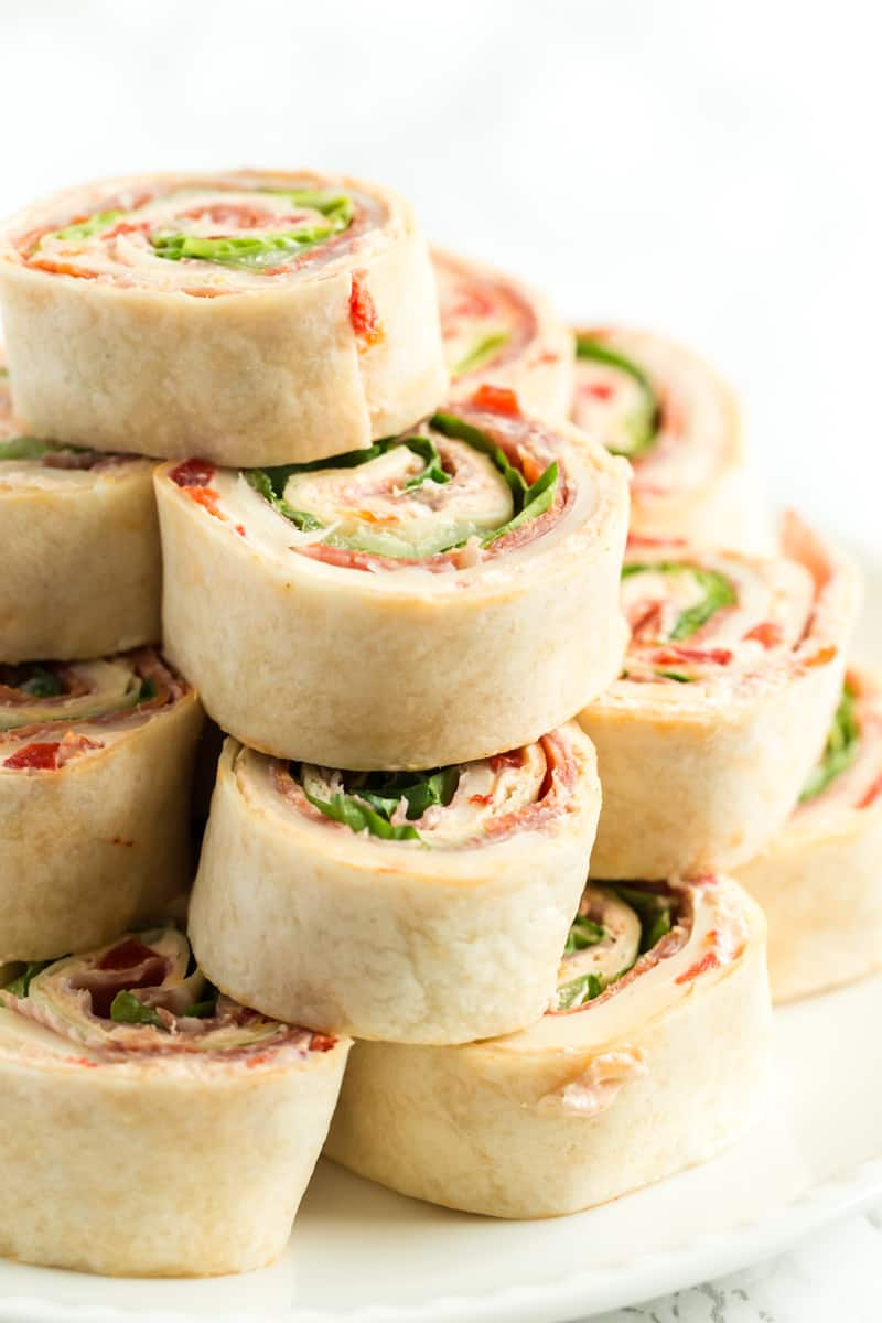 pinwheels stacked in a pyramid on plate ready to serve