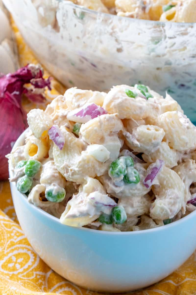 up close of tuna salad in bowl with peas and onions showing