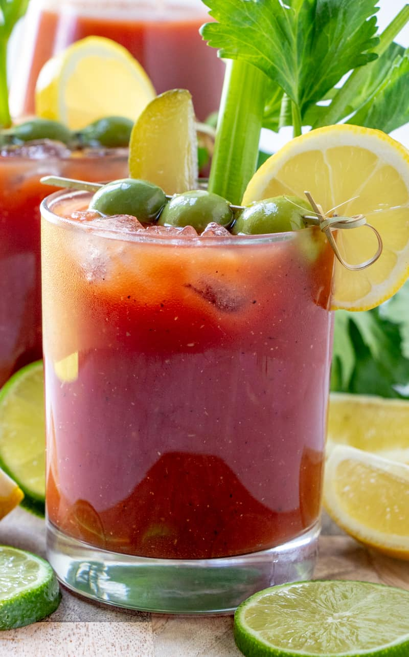 Side photo of Bloody Mary mix dressed up in glasses ready to serve