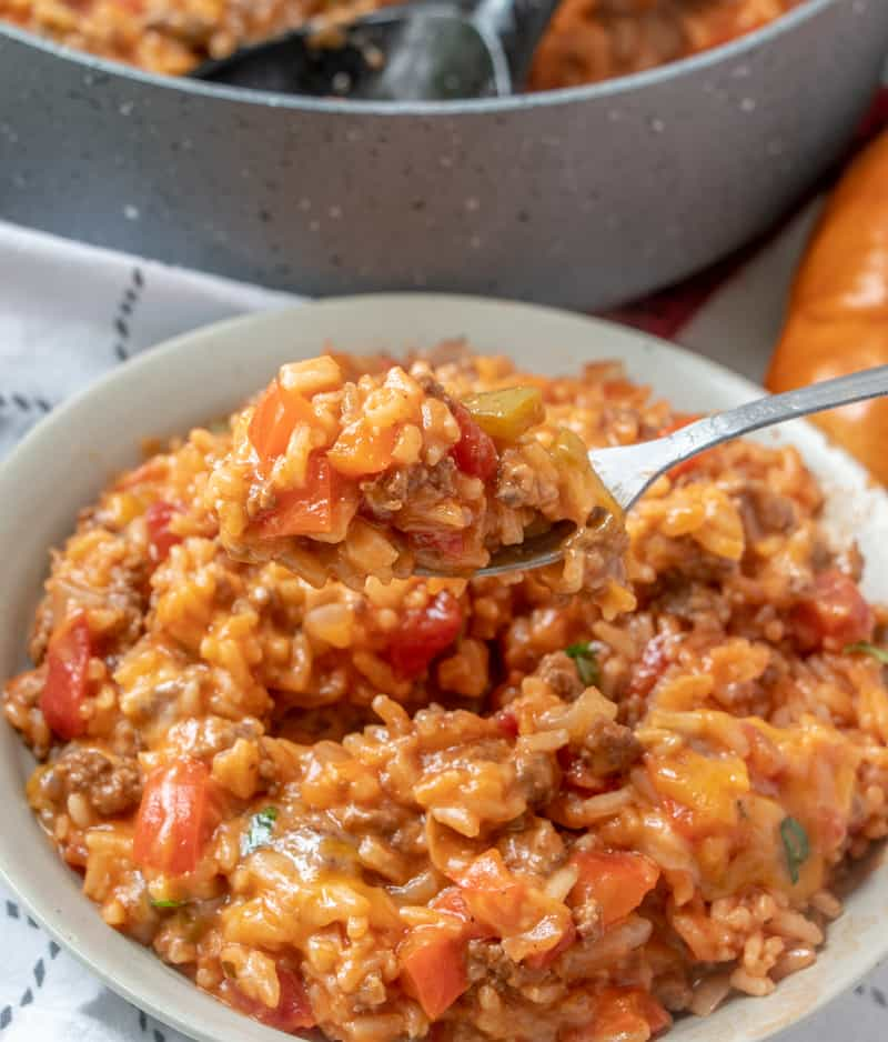 Stuffed pepper casserole recipe on fork being served