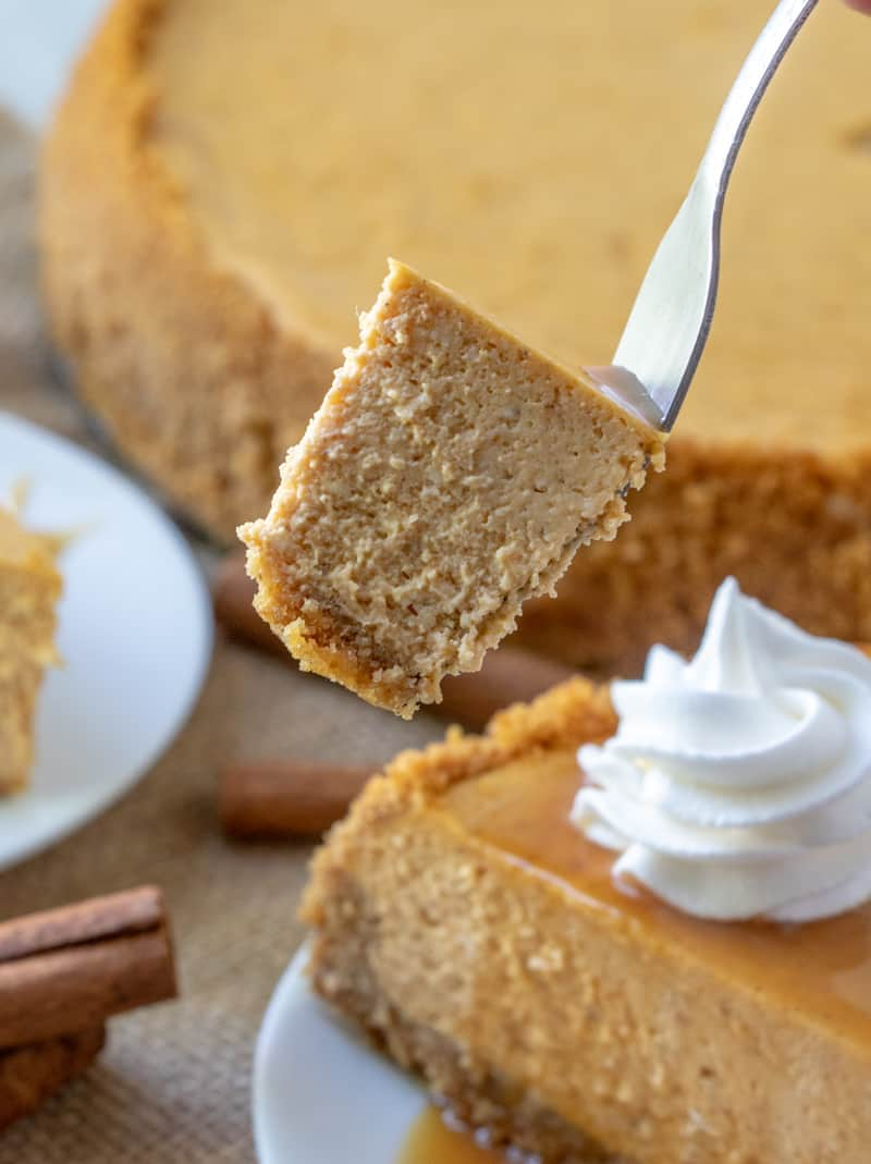Bite of pumpkin cheesecake on fork