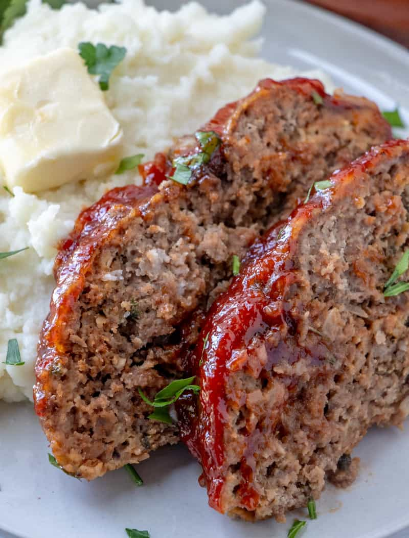 Up close photo of slices of meatloaf with broiled on glaze