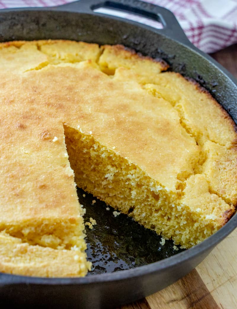 Slice of cornbread taken out of skillet
