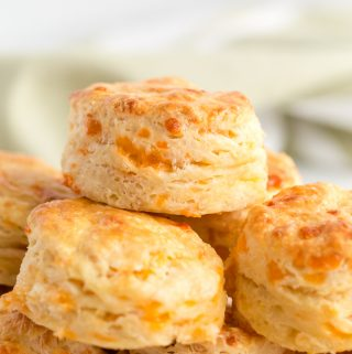Biscuits stacked on top of one another on white serving tray
