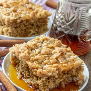 Two plates with baked oatmeal garnished with cinnamon sticks