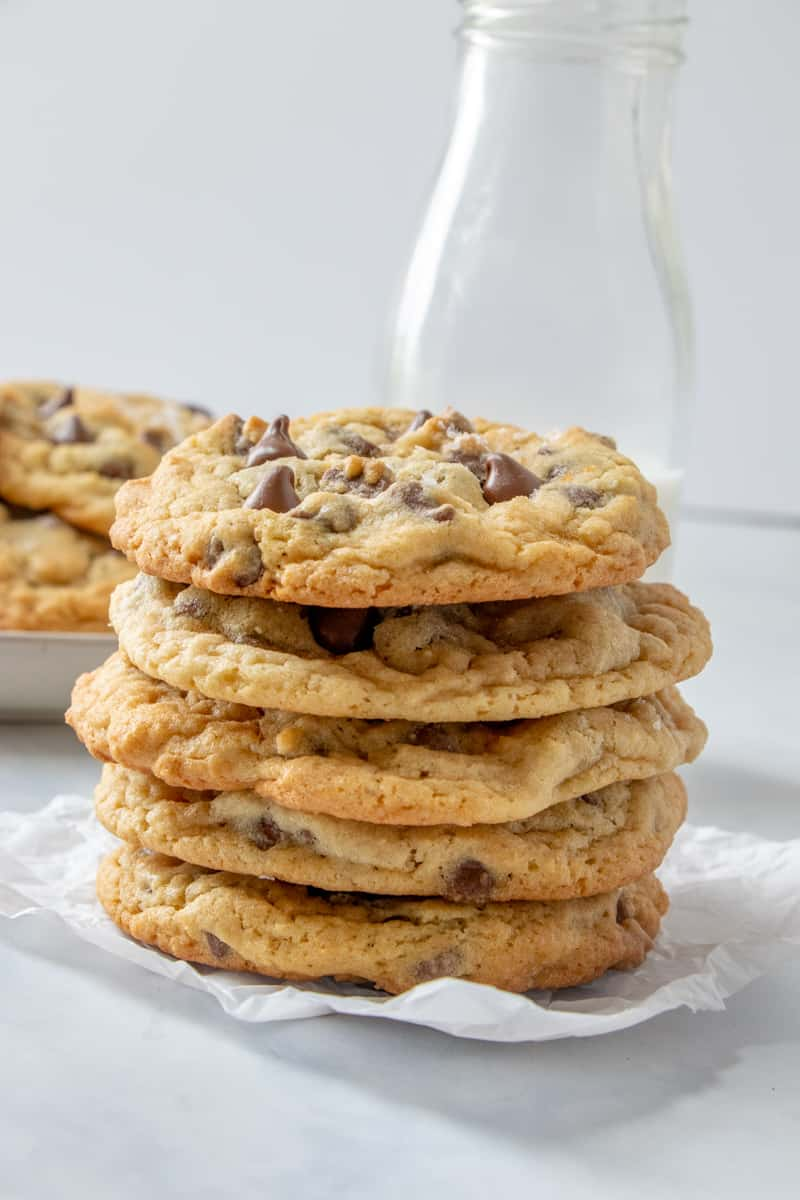 5 cookies stacked on top of one another showing golden edges
