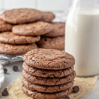 cookies stacked on top of one another with cooling rack of cookies background