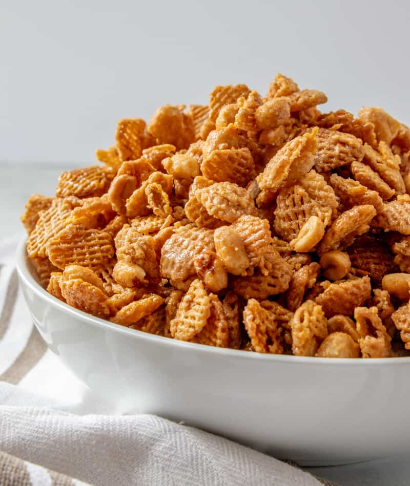 Close up side view of snack mix in large bowl before serving