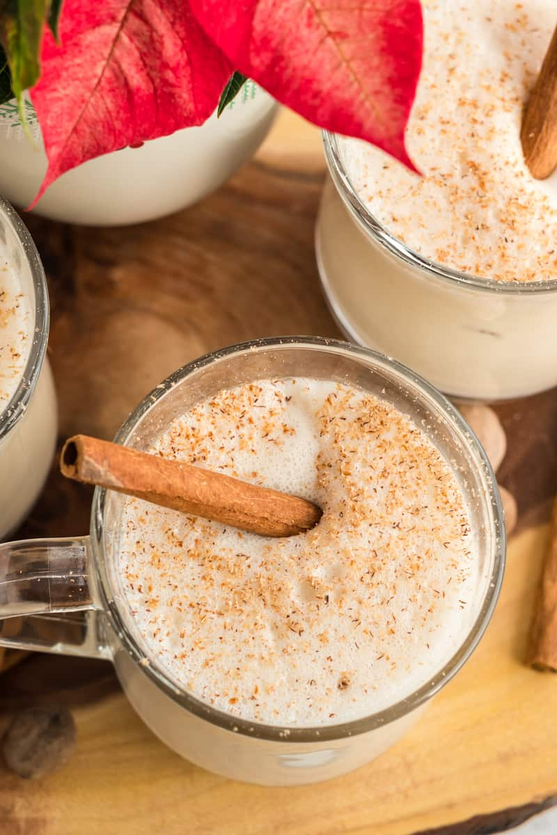 Overhead photo looking into mug of eggnog sprinkled with nutmeg and cinnamon