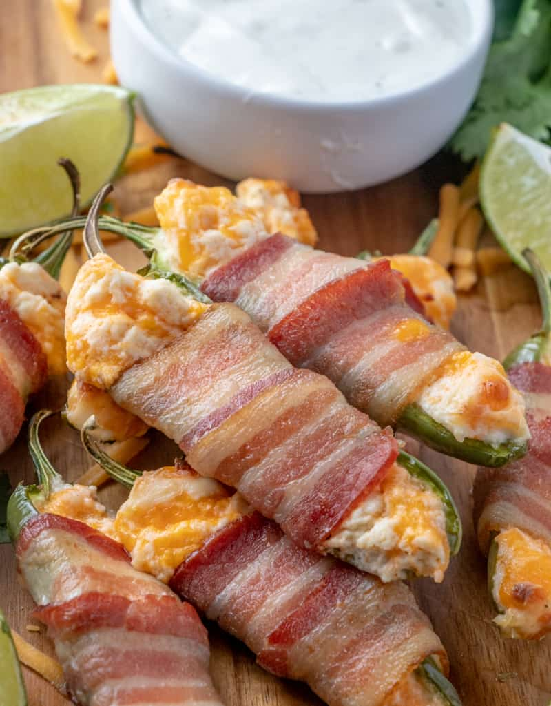 Bacon Wrapped Jalapeno Poppers with gooey cheesy limes and ranch dressing