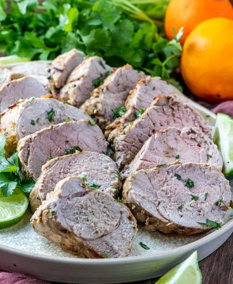 Sliced Pork Tenderloin on plate with sprinkles of cilantro