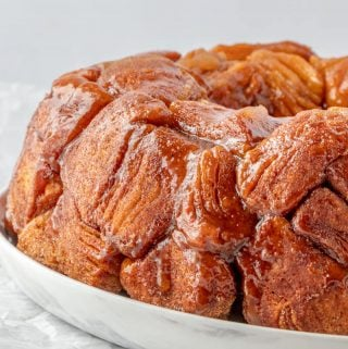 side view of finished glazed monkey bread on serving platter