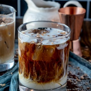 White Russian served after cream has been added and topped with a little chocolate shavings
