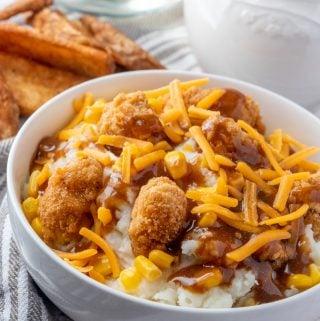 KFC Bowls with chicken, potatoes, gravy, corn and cheese
