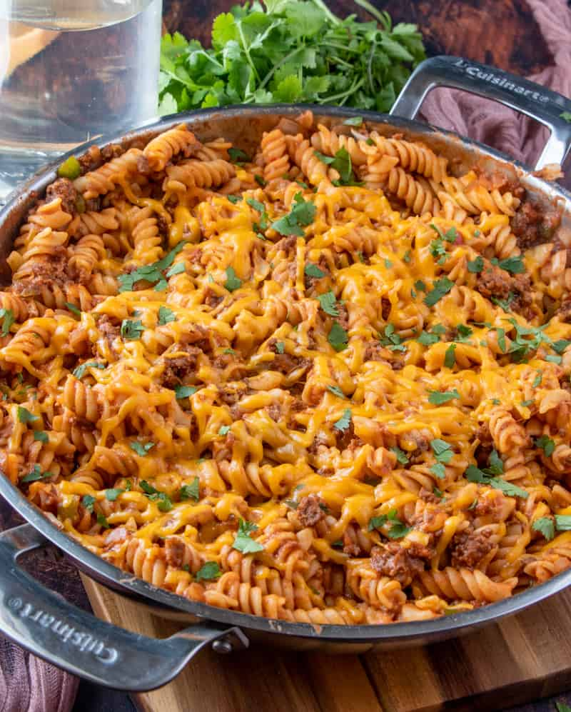 Sloppy Joe Casserole finished in pan with melted cheese and topped with chopped parsley