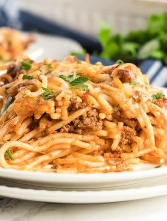 square photo of a slice of spaghetti casserole on two white plates