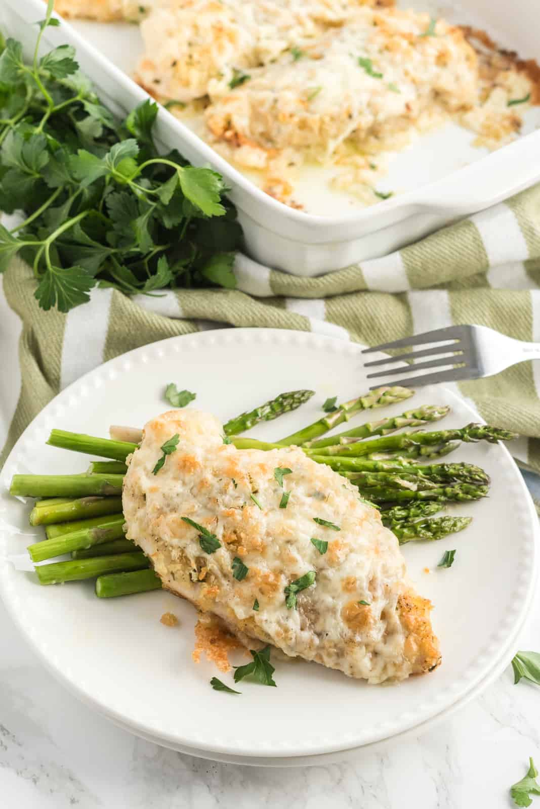 Chicken breast on plate with asparagus