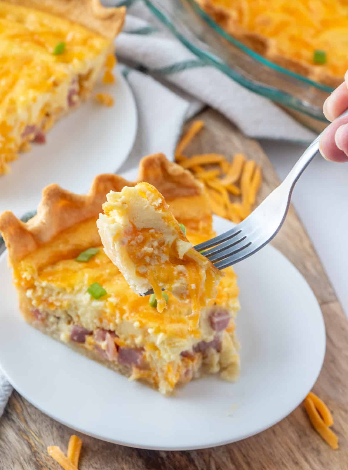 Forkful of a bite of quiche