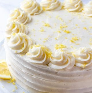 baked and decorated lemon layer cake on turntable