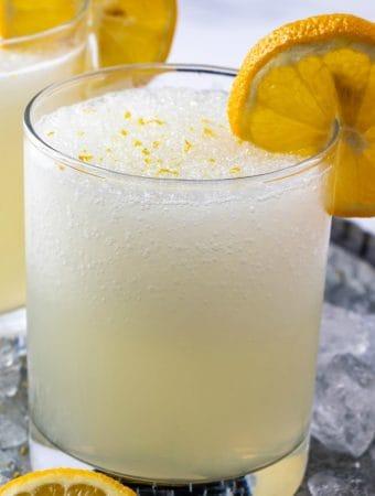 Featured square image of Frozen Lemonade garnished with lemon slice