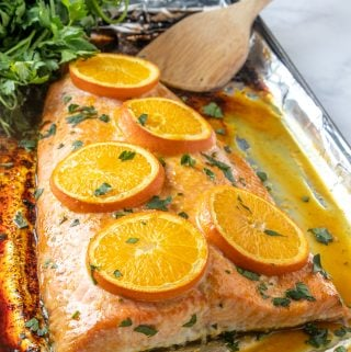 Large salmon filet baked with oranges and parsley