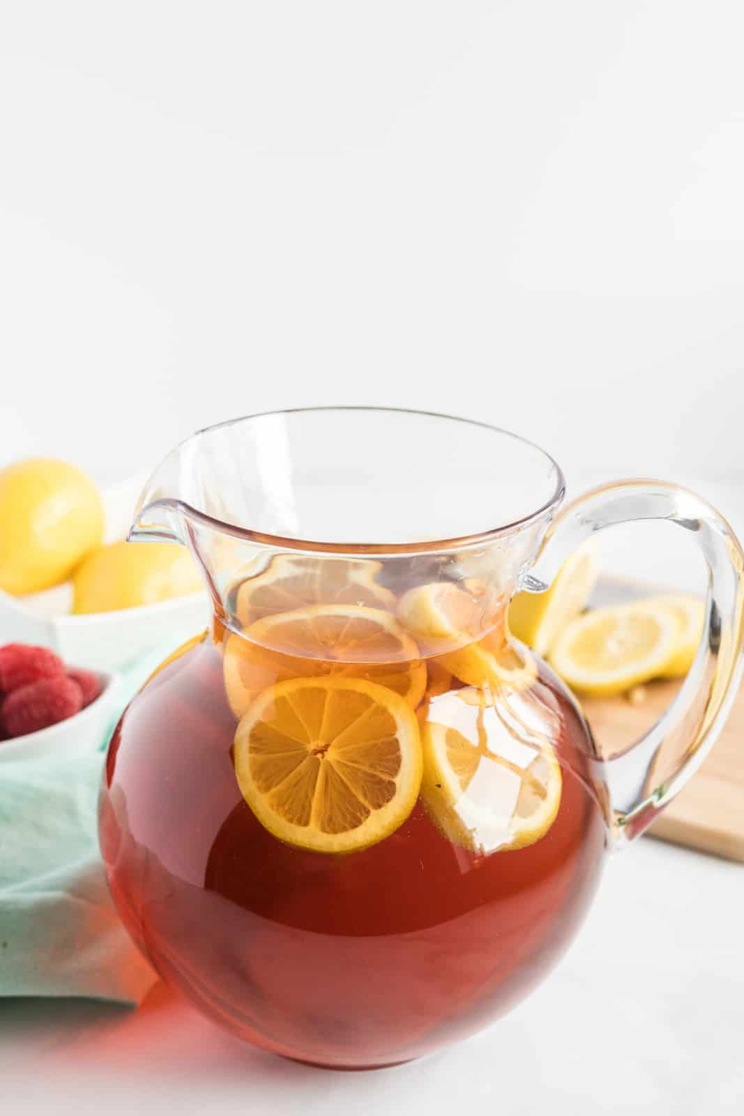 Sweet Tea in large pitcher with lemon slices