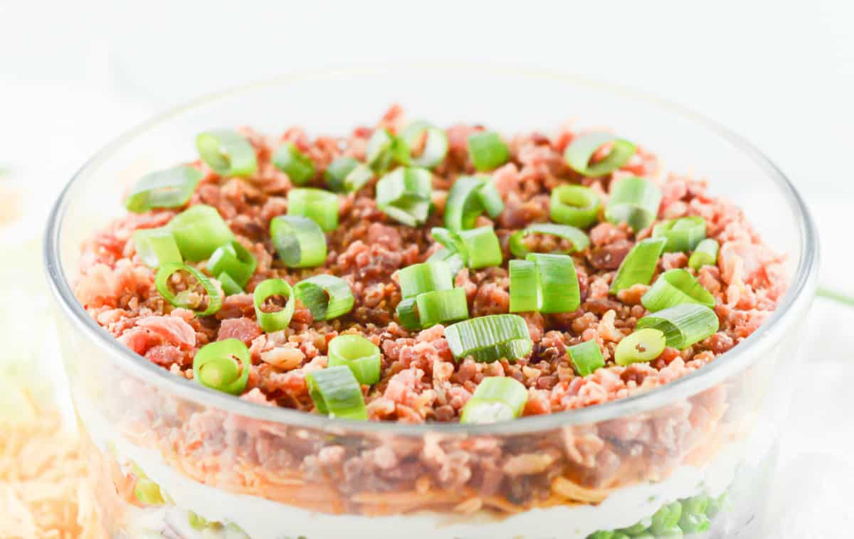 Close up of seven layer salad topping