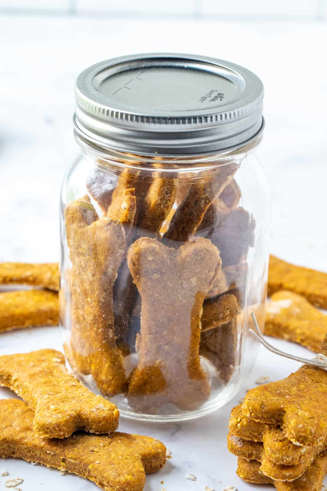 Dog Treats in sealed mason jar surrounded by other treats